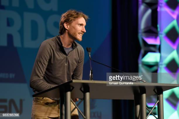 Ian Dallas accepts an award onstage at SXSW Gaming Awards during SXSW at Hilton Austin Downtown on March 17 2018 in Austin Texas