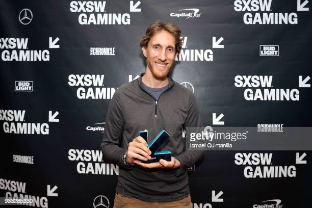 Ian Dallas poses with an award at SXSW Gaming Awards during SXSW at Hilton Austin Downtown on March 17 2018 in Austin Texas