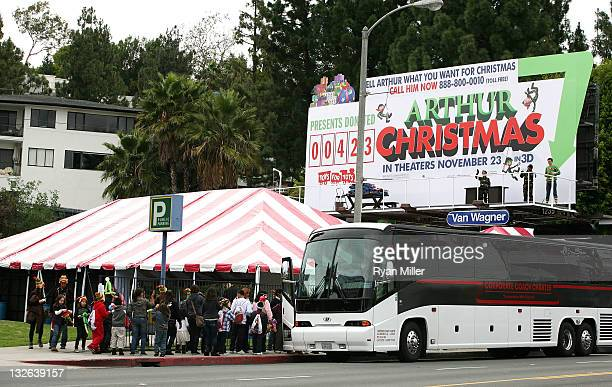 Ian Delaney is seen on his billboard as the 12 Days of 'Arthur Christmas' kicks off across the country highlighted by the Living Billboard on LA's...