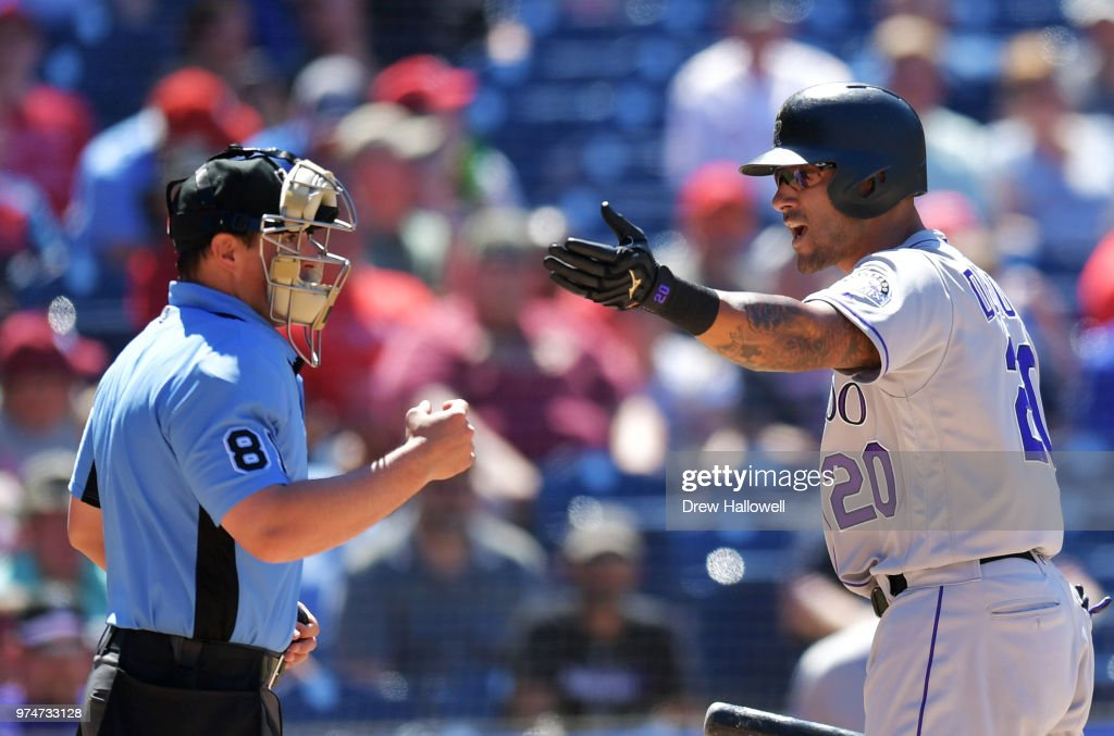 Ian Desmond #20 of the Colorado Rockies argues with umpire Jeff Kellogg #8 after getting called out in the seventh inning against the Philadelphia Phillies at Citizens Bank Park on June 14, 2018 in Philadelphia, Pennsylvania.