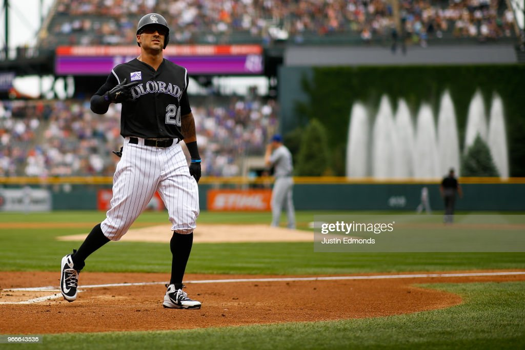 Ian Desmond #20 of the Colorado Rockies celebrates after hitting a two run home run off of starting pitcher Alex Wood #57 of the Los Angeles Dodgers during the first inning at Coors Field on June 3, 2018 in Denver, Colorado.