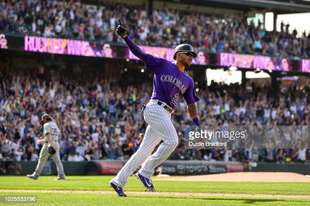 Ian Desmond of the Colorado Rockies celebrates on the base path after hitting a ninth inning 2run walk off homerun off of Kirby Yates of the San...