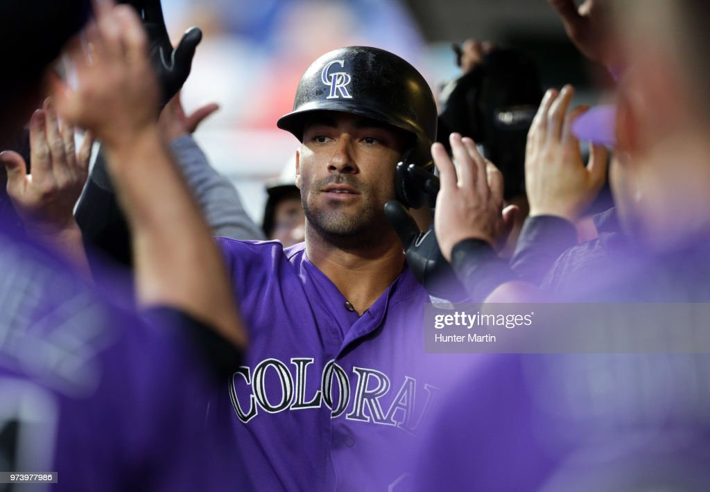 Ian Desmond #20 of the Colorado Rockies high-fives teammates in the dugout after hitting a two-run home run in the fourth inning during a game against the Philadelphia Phillies at Citizens Bank Park on June 13, 2018 in Philadelphia, Pennsylvania. The Rockies won 7-2.