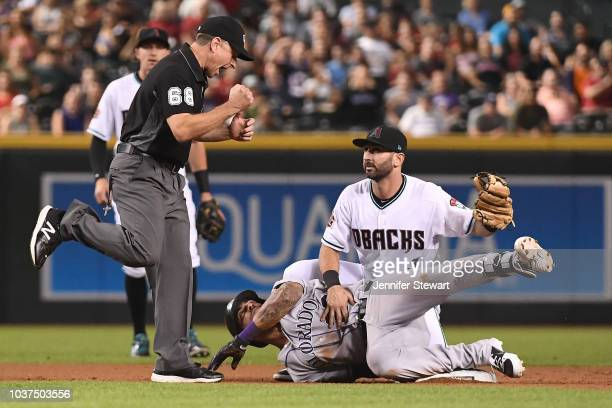 Ian Desmond of the Colorado Rockies is tagged out by Daniel Descalso of the Arizona Diamondbacks in the fifth inning of the MLB game at Chase Field...