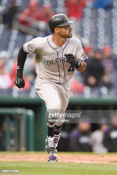 Ian Desmond of the Colorado Rockies runs to first base during a baseball game against the Washington Nationals at Nationals Park on April 15 2018 in...
