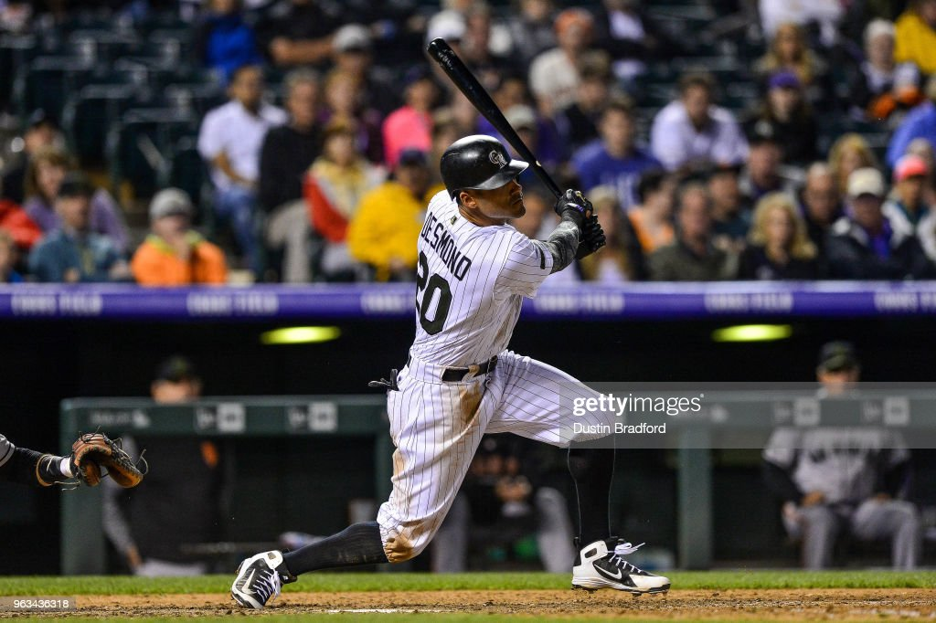 Ian Desmond #20 of the Colorado Rockies singles in the bottom of the 10th inning against the San Francisco Giants at Coors Field on May 28, 2018 in Denver, Colorado.