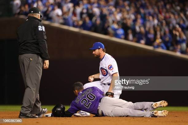 Ian Desmond of the Colorado Rockies tagged out by Daniel Murphy of the Chicago Cubs during the National League Wild Card game at Wrigley Field on...