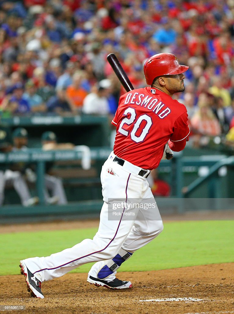 Ian Desmond #20 of the Texas Rangers hits a single RBI in the seventh inning against the Oakland Athletics at Globe Life Park in Arlington on August 17, 2016 in Arlington, Texas.
