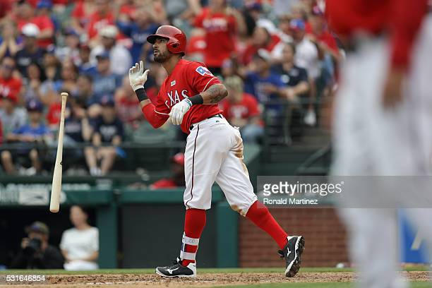 Ian Desmond of the Texas Rangers hits a threerun homerun in the seventh innning against the Toronto Blue Jays at Globe Life Park in Arlington on May...
