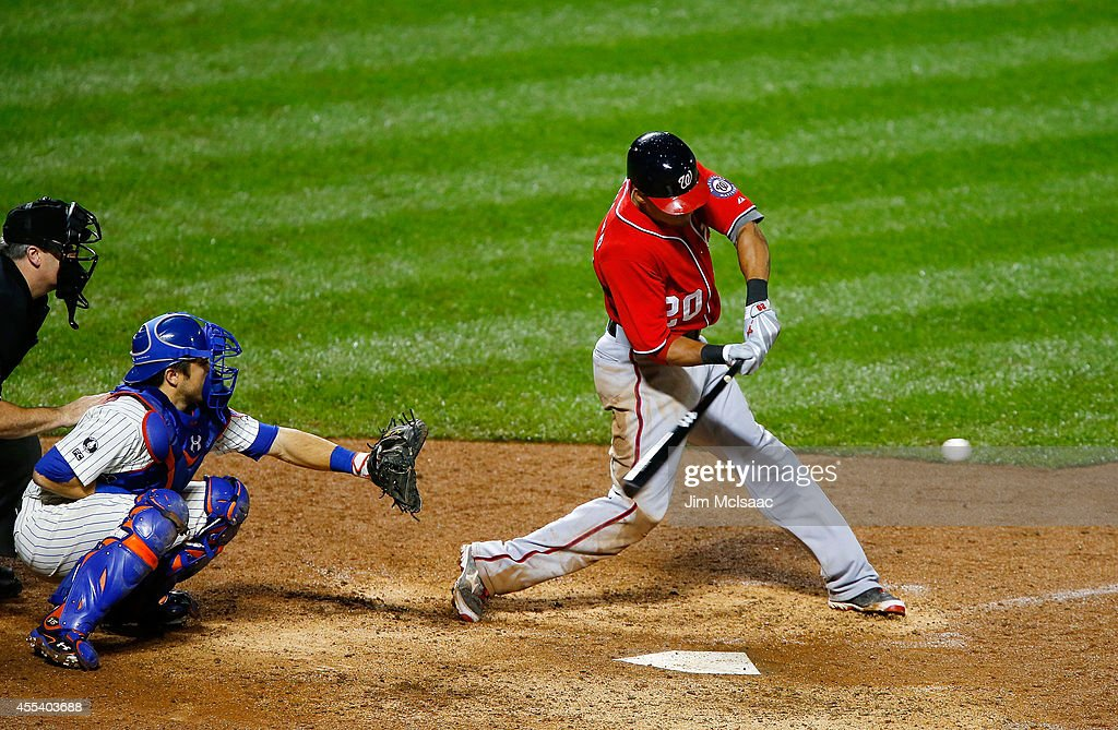 Ian Desmond #20 of the Washington Nationals connects on an eighth inning RBI double against the New York Mets at Citi Field on September 13, 2014 in the Flushing neighborhood of the Queens borough of New York City.