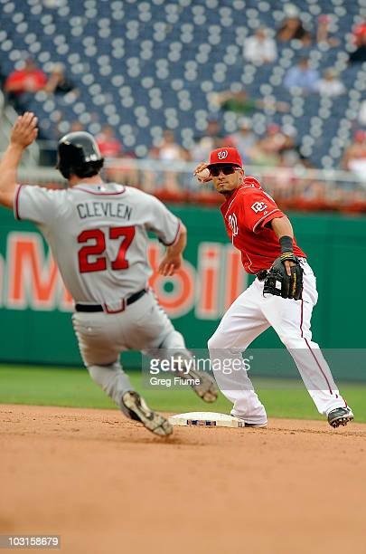 Ian Desmond of the Washington Nationals forces out Brent Clevlen of the Atlanta Braves to start a double play at Nationals Park on July 29, 2010 in...