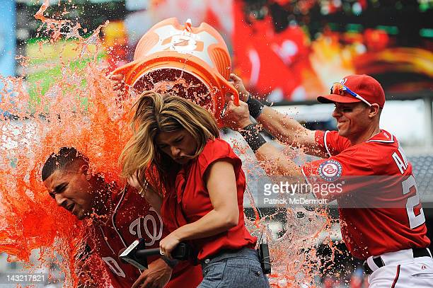 Ian Desmond of the Washington Nationals is doused with Gatorade by his teammates after hitting the game winning sacrifice fly to center in the bottom...