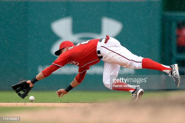 Ian Desmond of the Washington Nationals is unable to catch a single hit by Juan Lagares of the New York Mets in the ninth inning during a game at...