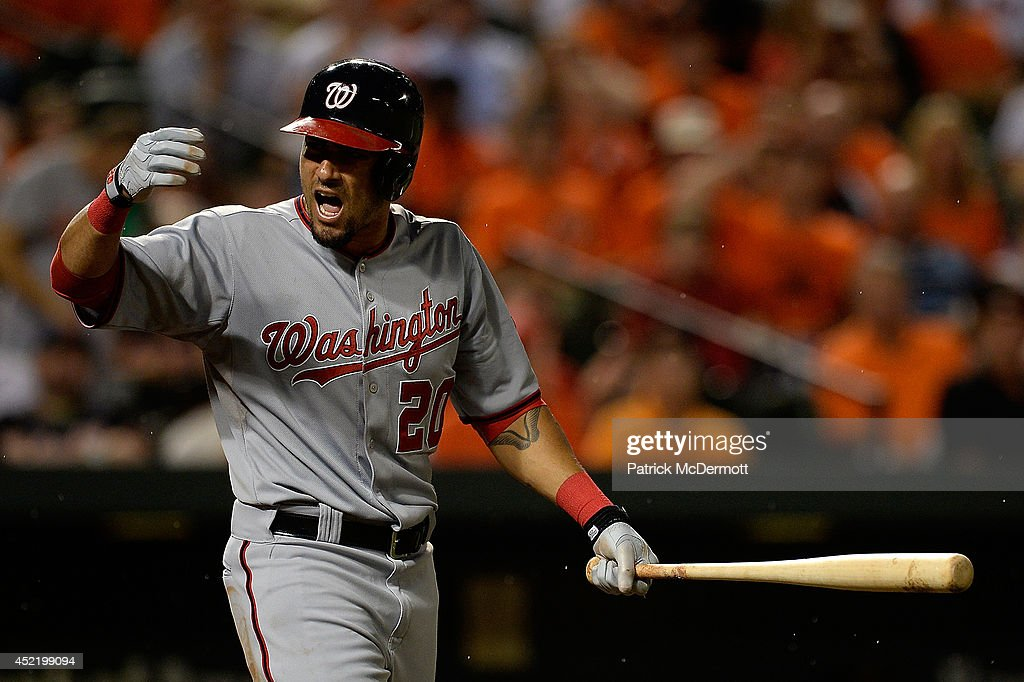 Ian Desmond #20 of the Washington Nationals reacts after being hit by a pitch thrown by Darren O'Day #56 of the Baltimore Orioles in the eighth inning during a game at Oriole Park at Camden Yards on July 10, 2014 in Baltimore, Maryland.