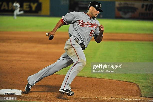 Ian Desmond of the Washington Nationals rounds third base during a MLB game against the Florida Marlins at Sun Life Stadium on September 1 2010 in...