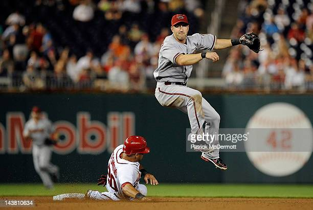 Ian Desmond of the Washington Nationals slides into second base as Willie Bloomquist of the Arizona Diamondbacks turns a double play in the eighth...