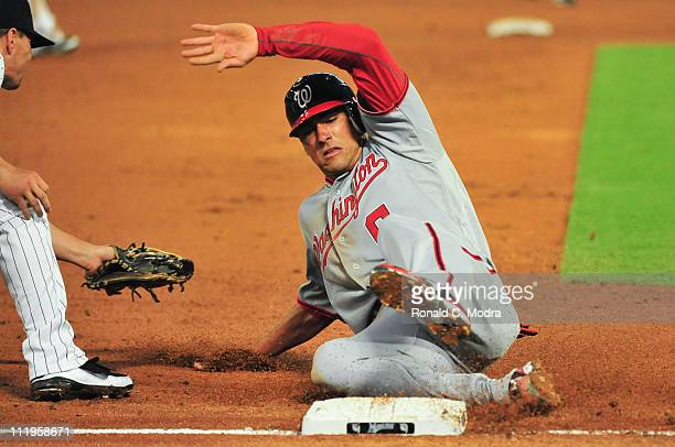 Ian Desmond of the Washington Nationals slides into third base during a MLB game against the Florida Marlins at Sun Life Stadium on April 6 2011 in...