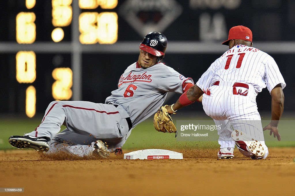 Ian Desmond #6 of the Washington Nationals slides past second base on a steal before being tagged out by Jimmy Rollins #11 of the Philadelphia Phillies at Citizens Bank Park on August 12, 2011 in Philadelphia, Pennsylvania. The Nationals won 4-2.