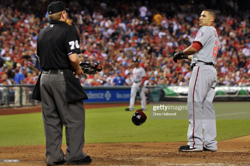 Ian Desmond #20 of the Washington Nationals stares at home plate umpire umpire Mike Muchlinski #76 after getting called out on strikes during the game against the Philadelphia Phillies at Citizens Bank Park on September 27, 2012 in Philadelphia, Pennsylvania. The Nationals won 7-3.