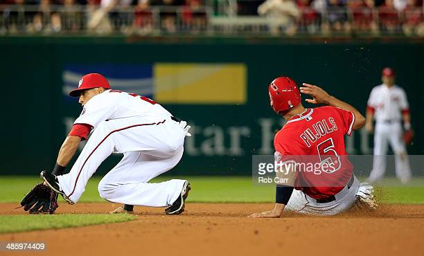 Ian Desmond of the Washington Nationals waits for the throw as Albert Pujols of the Los Angeles Angels steals second base during the eighth inning of...
