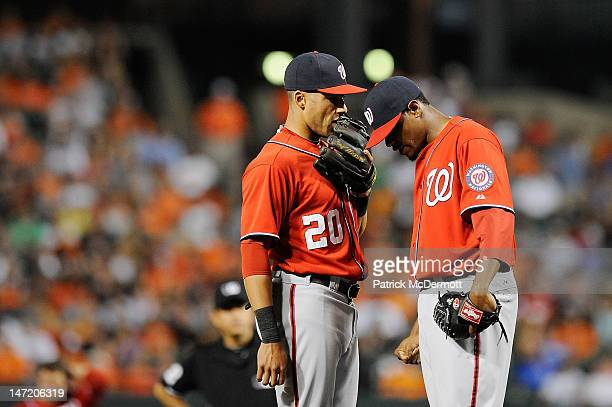 Ian Desmond talks with Edwin Jackson of the Washington Nationals during a game against the Baltimore Orioles during an interleague game at Oriole...