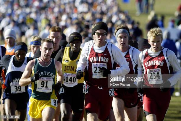 Ian Dobson Adam Tenforde and Ryan Hall of Stanford University lead the pack during the Division I Men's Cross Country Championship held at the Irv...