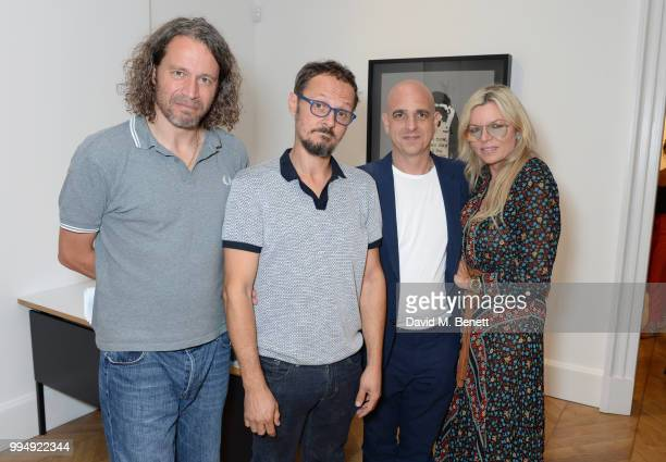 Ian Ellis Fru Tholstrup Steve Lazarides and Jonathan Yeo attend the Bansky 'Greatest Hits 20022008' exhibition VIP preview at Lazinc on July 9 2018...
