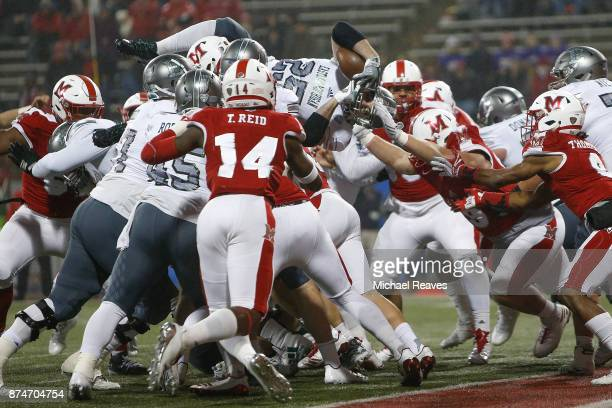 Ian Eriksen of the Eastern Michigan Eagles dives over the line of scrimmage just short of a touchdown against the Miami Ohio Redhawks during the...