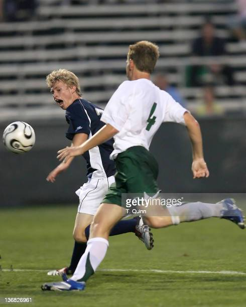 Ian Etherington of Notre Dame pushes the ball forward as Dean Sorrell of UAB tries to catch up during the Mike Berticelli Memorial Tournament at...