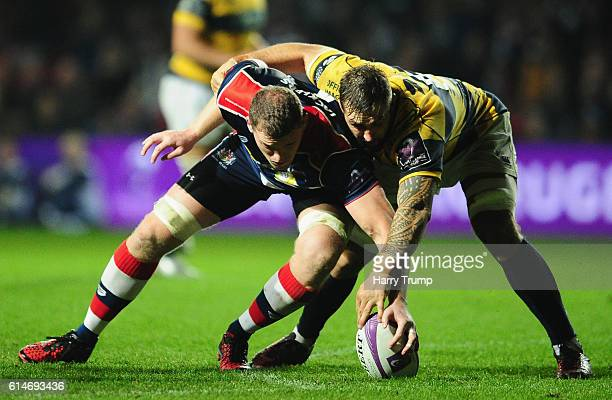 Ian Evans of Bristol Rugby attempts to get the ball from Macauley Cook of Cardiff Blues during the European Rugby Challenge Cup between Bristol Rugby...