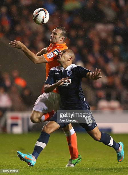 Ian Evatt of Blackpool battles for the ball with James Vaughan of Huddersfield Town during the npower Championship match between Blackpool and...