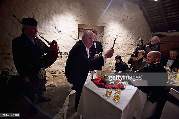Ian Farrell addresses the haggis at a Burns Supper at Burns cottage on January 25 2016 in Alloway Scotland This is the first time in more than 200...