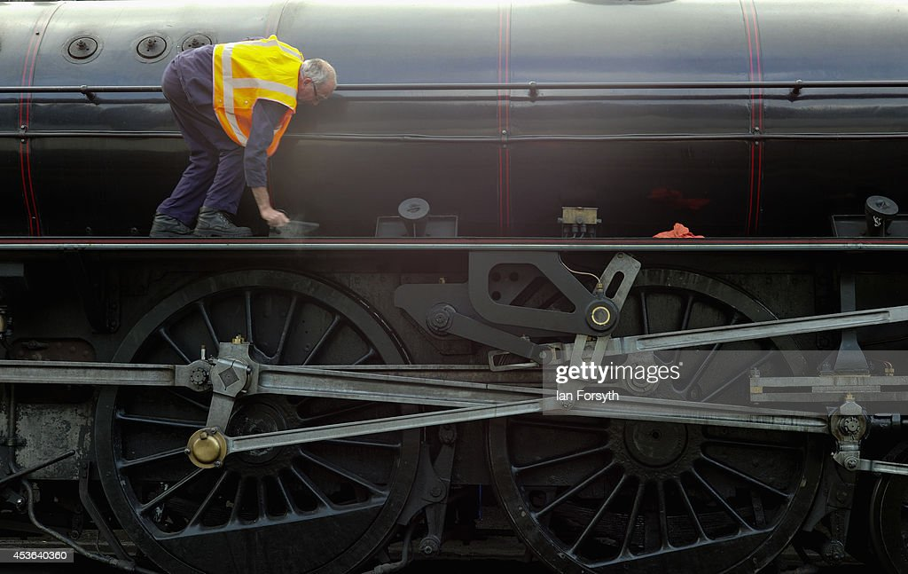 Ian Foot, the fireman on the locomotive 'Chiru' makes final preparations at Grosmont train engine sheds prior to a ceremony to mark a second platform opening at Whitby train station on August 15, 2014 in Whitby, England. The second platform will provide passengers with more options for travel to the Yorkshire seaside town on the North Yorkshire Moors Railway and was the first time in half a century two steam locomotives were side by side at the station.