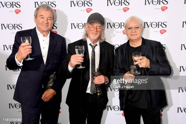 Ian Gillain, Roger Glover and Ian Paice from Deep Purple pose in the winners room after winning the Ivor Novello International Achievement award at...