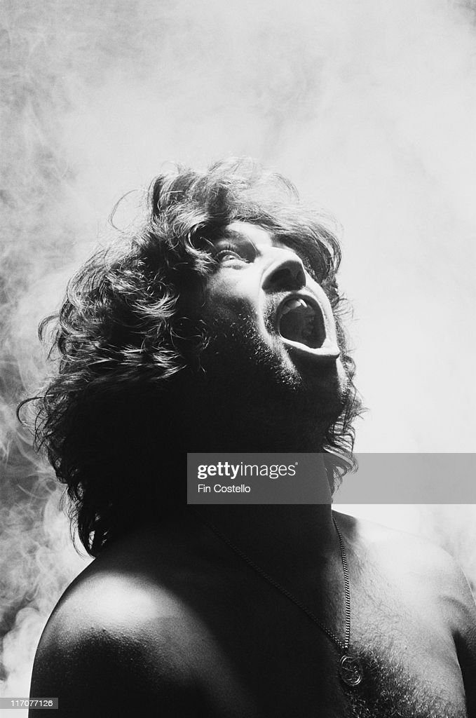 Ian Gillan, British rock singer, posing open-mouthed and bare-chested, with smoke behind him, for a studio portrait, at Kingsway Studios, London, England, Great Britain, 1978.