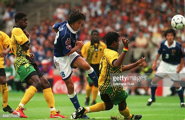 Ian Goodison and Jo Shoji during the Japan vs Jamaica soccer game at the 1998 soccer World Cup