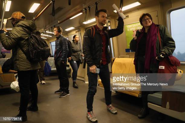 Ian Griffiths center and Adina Levin right of the group Seamless Transit travel on a BART train on Thursday Nov 15 in Oakland Calif The advocacy...
