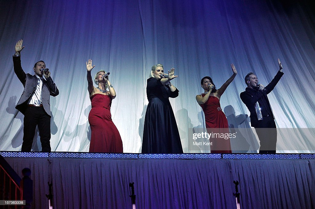 Ian 'H' Watkins, Faye Tozer, Claire Richards, Lisa Scott-Lee and Lee Latchford-Evans of Steps perform at London Palladium on December 2, 2012 in London, England.
