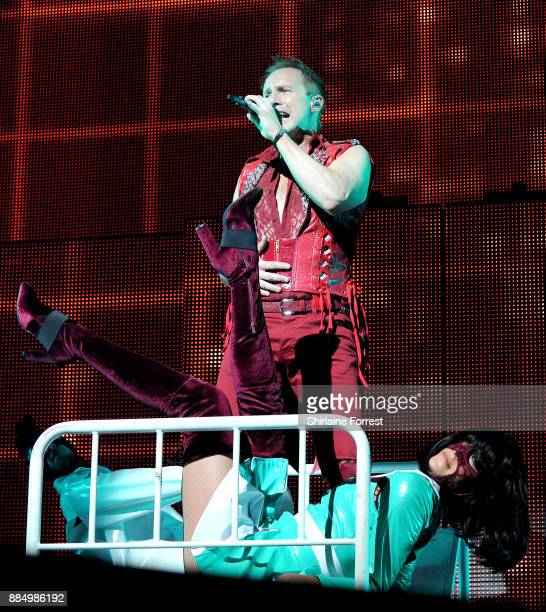 Ian 'H' Watkins of Steps performs live on stage at Manchester Arena on December 3 2017 in Manchester England