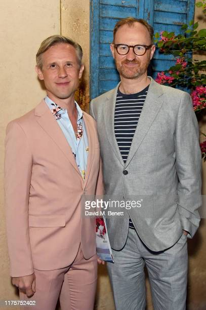 Ian Hallard and Mark Gatiss attend the opening night of MAMMA MIA! The Party at Building 6 at The O2 on September 19, 2019 in London, England.