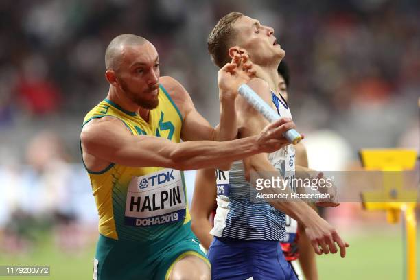 Ian Halpin of Australia collides with Lee Thompson of Great Britain in the Men's 4x400 metres relay heats during day nine of 17th IAAF World...