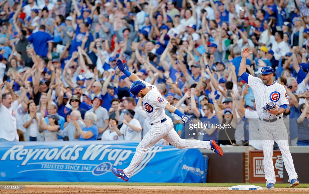 Ian Happ #8 of the Chicago Cubs celebrates as he rounds the bases after hitting a three run home run against the St. Louis Cardinals during the fourth inning at Wrigley Field on June 4, 2017 in Chicago, Illinois.