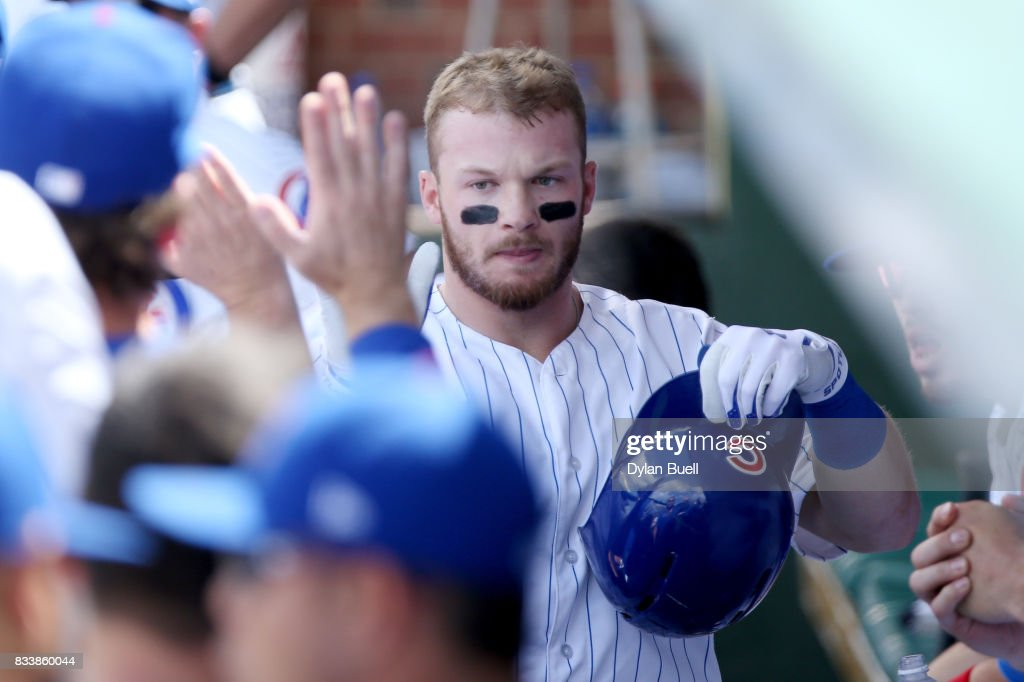 Ian Happ #8 of the Chicago Cubs celebrates with teammates after hitting a home run in the second inning against the Cincinnati Reds at Wrigley Field on August 17, 2017 in Chicago, Illinois.