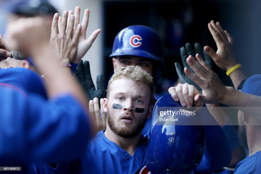 Ian Happ #8 of the Chicago Cubs celebrates with teammates after scoring a run in the eighth inning against the Milwaukee Brewers at Miller Park on September 23, 2017 in Milwaukee, Wisconsin.