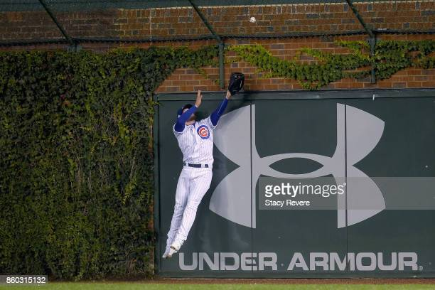 Ian Happ of the Chicago Cubs fails to catch a grand slam hit by Michael Taylor of the Washington Nationals in the eighth inning during game four of...