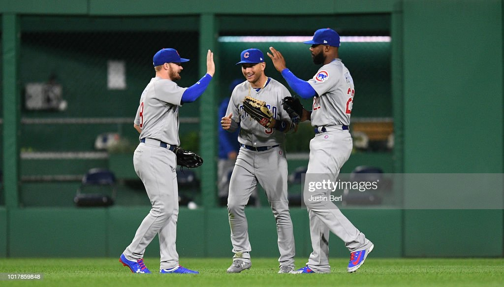 Ian Happ #8 of the Chicago Cubs high fives with Albert Almora Jr. #5 and Jason Heyward #22 after the final out in a 1-0 win over the Pittsburgh Pirates at PNC Park on August 16, 2018 in Pittsburgh, Pennsylvania.
