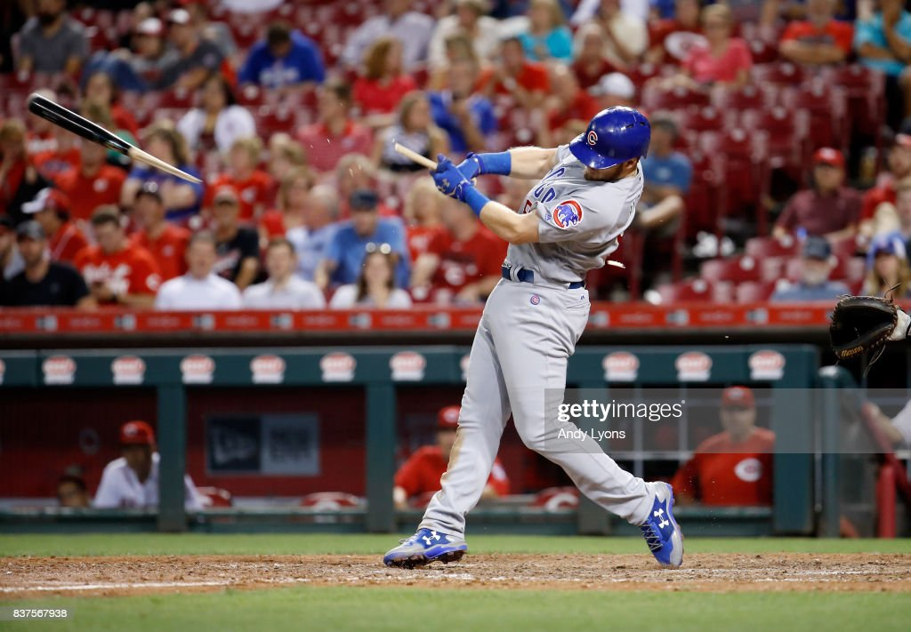 Ian Happ #8 of the Chicago Cubs hits a run scoring single in the 8th inning against the Cincinnati Reds at Great American Ball Park on August 22, 2017 in Cincinnati, Ohio.