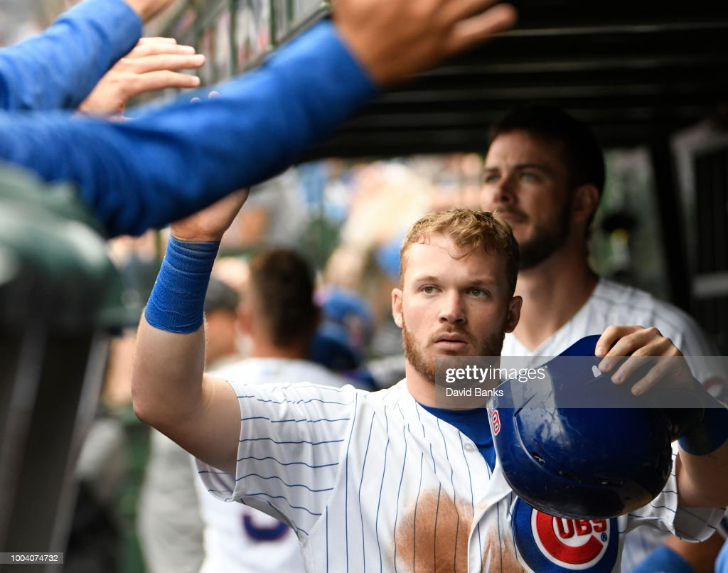 Ian Happ #8 of the Chicago Cubs is greeted after scoring against the St. Louis Cardinals during the eighth inning on July 22, 2018 at Wrigley Field in Chicago, Illinois.