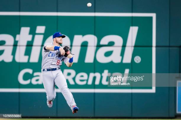 Ian Happ of the Chicago Cubs makes a leaping throw to first against the Washington Nationals during the fourth inning of game two of a doubleheader...
