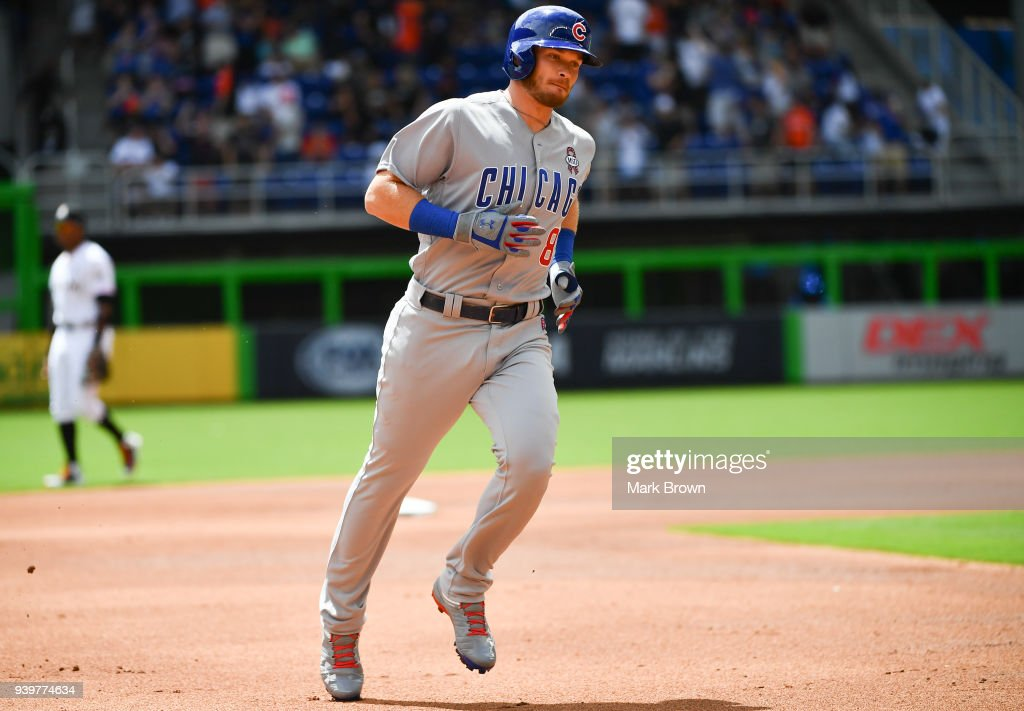 Ian Happ #8 of the Chicago Cubs rounds the bases after hitting a lead off home run off the first pitch in first inning during Opening Day against the Miami Marlins at Marlins Park on March 29, 2018 in Miami, Florida.